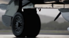 Shot underneath Cessna private jet with engineer walking past. Stock Footage