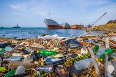 Stock Photo of COLON, PANAMA - APRIL 15, 2015: Waste and pollution washing on the shores of the
