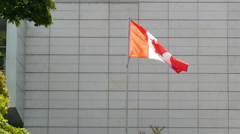 Canadian Flag in front of  Canadian embassy in Warsaw, Poland Stock Footage