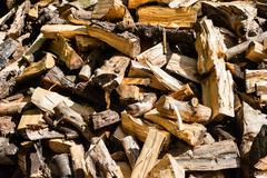 Abstract messy pile of chopped firewood - stock photo