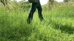 Walking through grass Mid Long Shot - stock footage