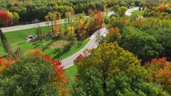 Scenic Rural Drive Amid Trees With Stunning Autumn Colors - stock footage
