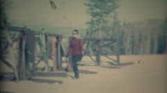 1967: Women visits traditional mountain ski winter resort. - stock footage