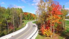 Scenic Rural Drive Amid Trees With Stunning Autumn Colors Stock Footage