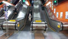 POV walk and enter escalator travel upwards, modern metro station Stock Footage