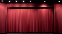 Red theater curtain opens to reveal cinema screen HD - stock footage