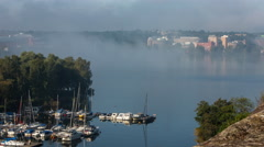 Boat club in Stockholm, Sweden covered in morning fog Stock Footage