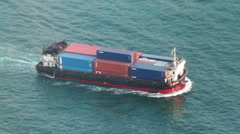 Aerial shot of small container ship crossing the habour Stock Footage