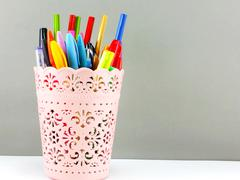Colorful holder full of pen and pencil office equipment for eduation or busin Kuvituskuvat