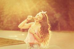 Pin-up girl with a lollipop and long hair. Stock Photos