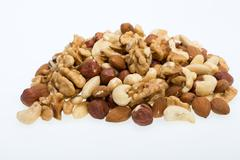 Mixed nuts  -  hazelnuts, walnuts, cashews,  pine nuts Stock Photos