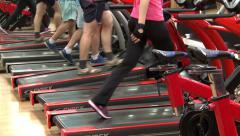 The fitness club. People do sport on a treadmill.. Stock Footage