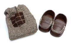 Stock Photo of Baby Clothes and Shoes