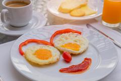 Happy Face Frying Eggs breakfast with coffee Stock Photos