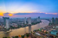 Landscape of river in Bangkok cityscape with sunset - stock photo