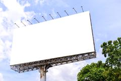 Blank billboard with rusted structure against blue sky for advertisement. Kuvituskuvat