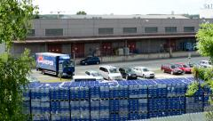 View of the outside warehouse behind building - goods - stand cars and truck Stock Footage