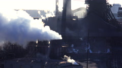Establishing shot of a busy steel mill with ore transported through an aerial Stock Footage