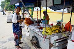 Thai people buy Champedak or Artocarpus integer at market - stock photo