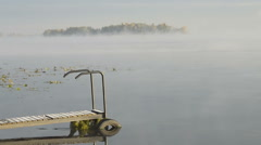 Fog over the water and the guy on the bridge Stock Footage