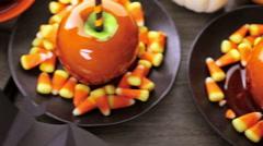 Handmade orange candy apples for Halloween. - stock footage