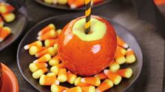 Handmade orange candy apples for Halloween. Stock Footage