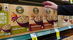 Woman selecting nature's path peanut butter granola in grocery store - stock footage