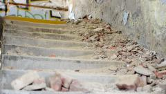 Broken bricks lie on the old stairs - messy interior Stock Footage