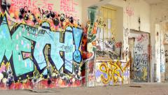 Colorful graffiti on the old wall of deserted building Stock Footage