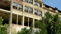 View of the old large building with many broken windows  Stock Footage