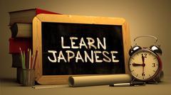 Learn JapaneseHandwritten by white Chalk on a Blackboard - stock illustration