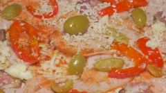 Cheese adding to pizza base with spices  and ham 4K 2160p UHD video - Prepari Stock Footage