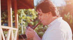 Adult Man is smoking cigar outdoors. Slow Motion 240 fps. Stock Footage