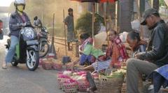 Ladies selling flowers on the street,Yogyakarta,Java,Indonesia Stock Footage