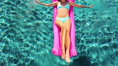 Beautiful Young Woman Relaxing in Luxury Pool, - stock footage