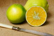 Stock Photo of The lime fruit close-up on wooden table.