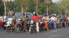 Motorcycles waiting for traffic light,Yogyakarta,Java,Indonesia Stock Footage