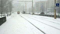 Tram arrives to the tram stop. It's snowing. Stock Footage