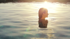 Beautiful Young Woman Relaxing in Luxury Pool, Spinning in Slow Circles - stock footage