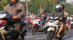 Motorcycles driving after green sign,Yogyakarta,Java,Indonesia Stock Footage