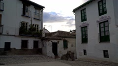 Weathered square in the Albayzin of Granada, Spain.  Pan up. Stock Footage