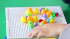 Small Child Playing In Multicolored Mosaic Stock Footage