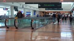 Passengers walk through a modern airport terminal. Stock Footage