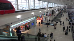 A rising shot of the interior of a modern airport in Detroit featuring elevated - stock footage