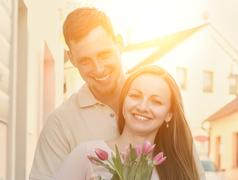 Couple meeting with flowers. - stock photo