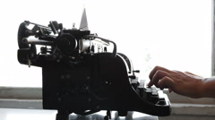 Man printing text with the typewriter, closeup view Stock Footage