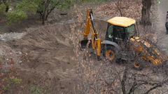 Backhoe tractor works on a construction site. Stock Footage
