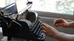 Man printing text with the typewriter, closeup view - stock footage