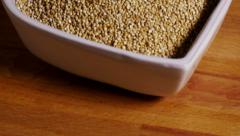Tilt up to reveal quinoa seeds in heart shaped bowl Stock Footage