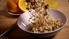 Granola muesli pouring into bowl, slow motion - stock footage